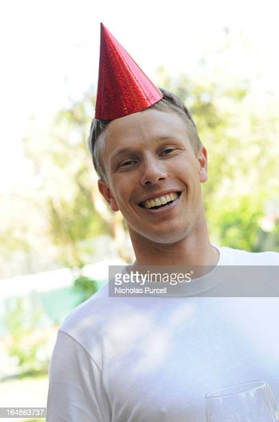 Man attends birthday party with hat