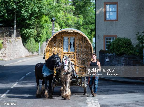 Man attends the Appleby Horse Fair, an annual gathering of travellers, in Cumbria.
