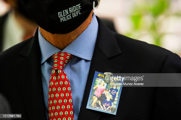 A man attends the funeral of Glen Ridge Police Officer Charles Roberts after he passed away from the coronavirus on May 14 2020 in Glen Ridge New...