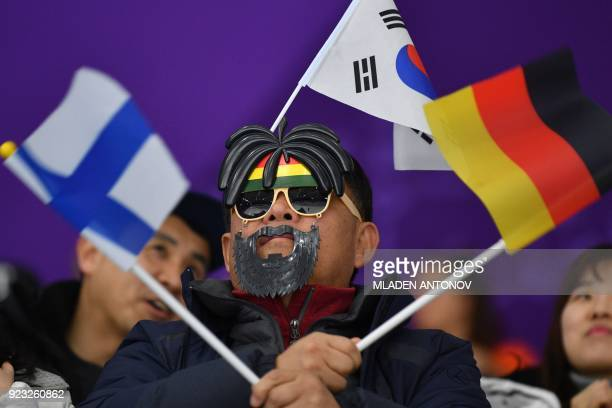 TOPSHOT A man attends the men's 1000m speed skating event during the Pyeongchang 2018 Winter Olympic Games at the Gangneung Oval in Gangneung on...