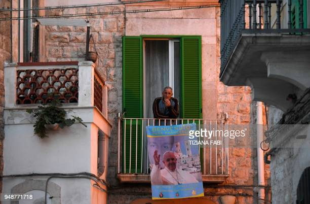 A man attends the pastoral visit of Pope Francis in Molfettaon 19 April 2018