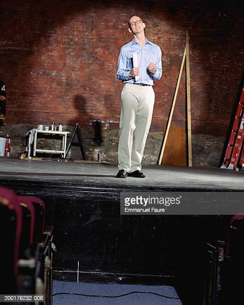 man auditioning on stage in theater - audition stock pictures, royalty-free photos & images