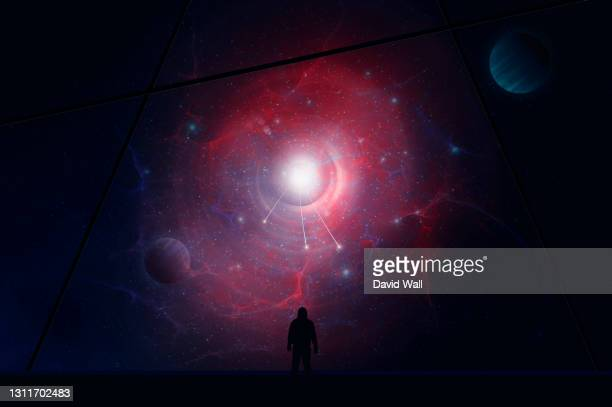 a man, back to camera, looking out of a spaceship window. with lights coming out of a portal, onto a universe of stars and planets. - door stock pictures, royalty-free photos & images