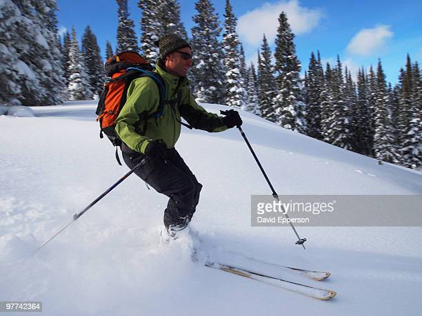 man backcountry skiing - ski pole stock pictures, royalty-free photos & images