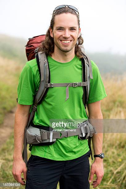 A man backpacking.