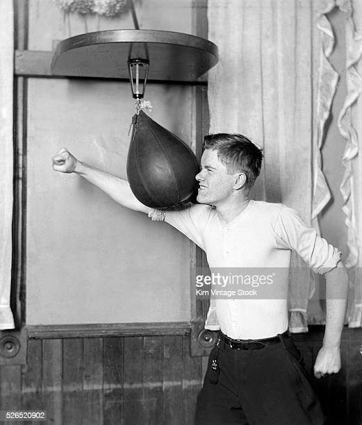 A man badly misses a punching bag while working out