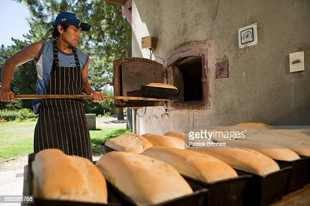 Man baking bread at Estancia Paso Flores