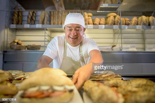 Man baking bread at the bakery
