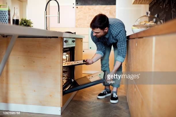 man baking pizza - oven stock pictures, royalty-free photos & images