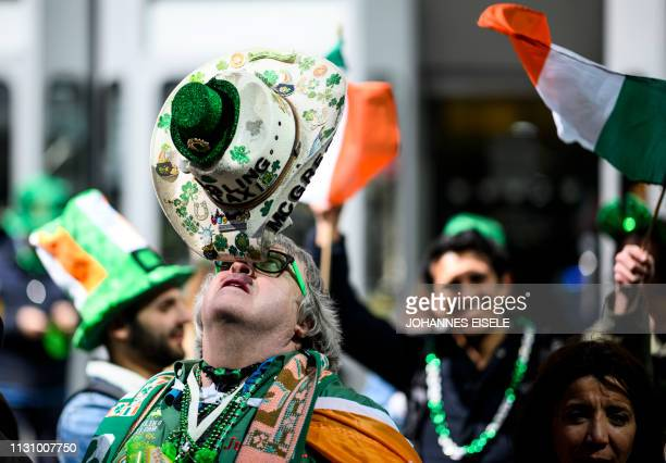 A man balances his hat during the annual New York City St Patrick's Day Parade on March 16 2019 The New York City St Patrick's Day parade dating back...
