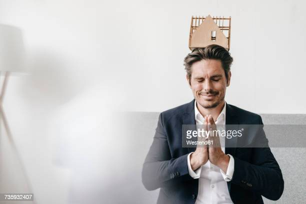 Man balancing an architectural model on his head
