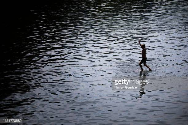 A man balancing on a slackline on the water is pictured on June 23 2019 in Koenigshain Germany