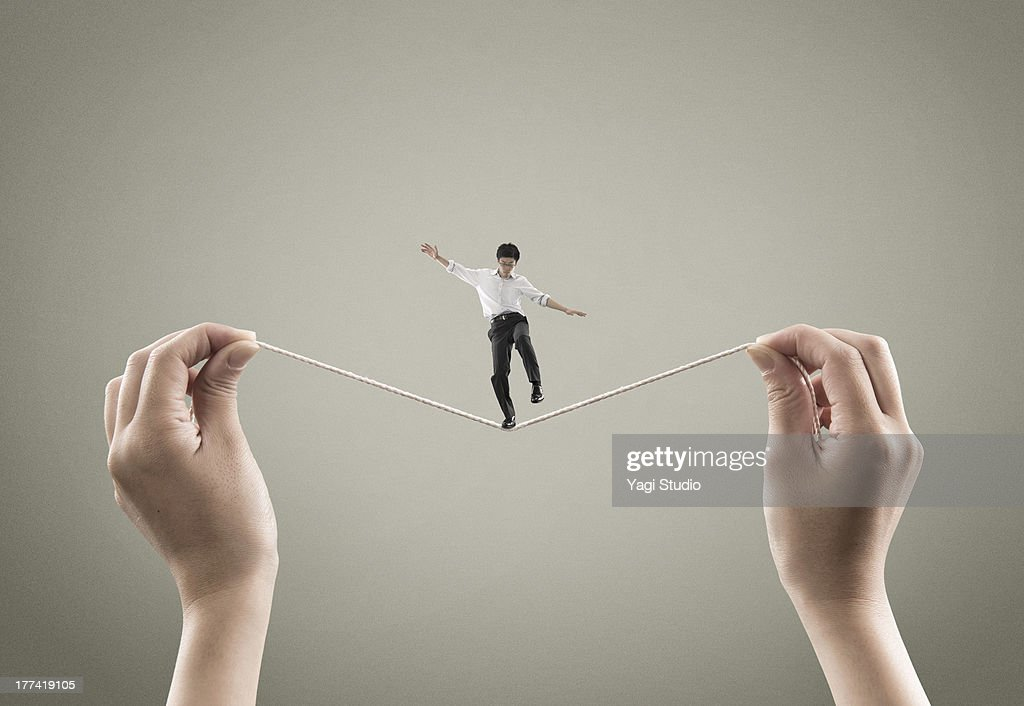 Man balancing on the rope : Stock Photo