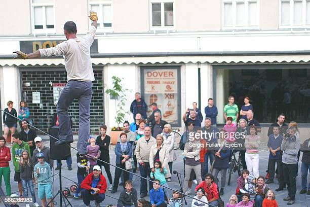 man balancing on tightrope - kranj stock pictures, royalty-free photos & images