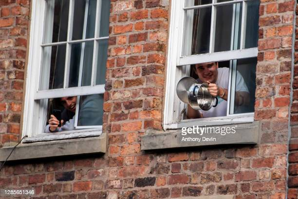 Man bangs a saucepan in support during an anti lockdown protest on November 14, 2020 in Liverpool, England. Throughout the Covid-19 pandemic, there...