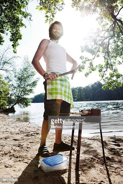 man barbeques a sausage - snag tree stock pictures, royalty-free photos & images