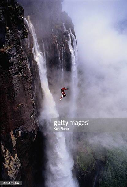man base jumping off angel falls, venezuela - angel falls stock photos and pictures