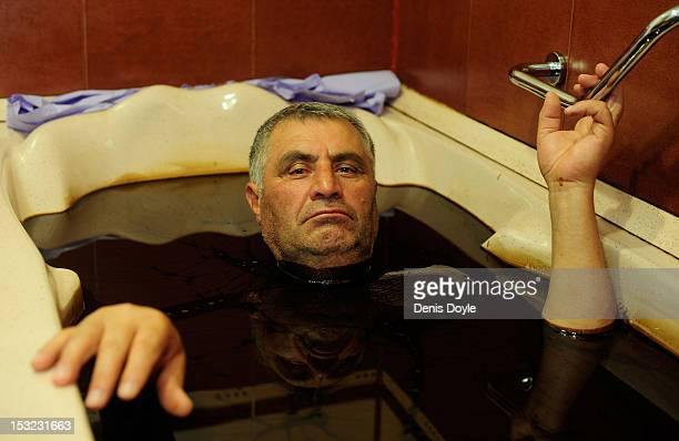 A man bathes in a bath full of heavy oil containing 50% naphthalene a hydrocarbon allegedly used to treat psoriasis rheumatism and artritis at the...