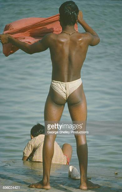 Man bathing at a ghat on the Ganges river