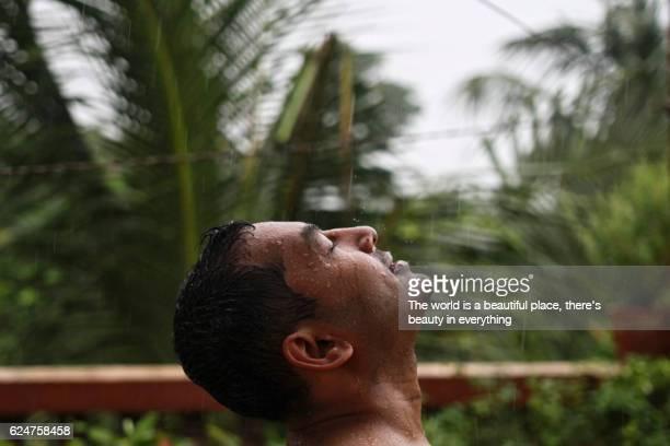 Man bathing in the rain