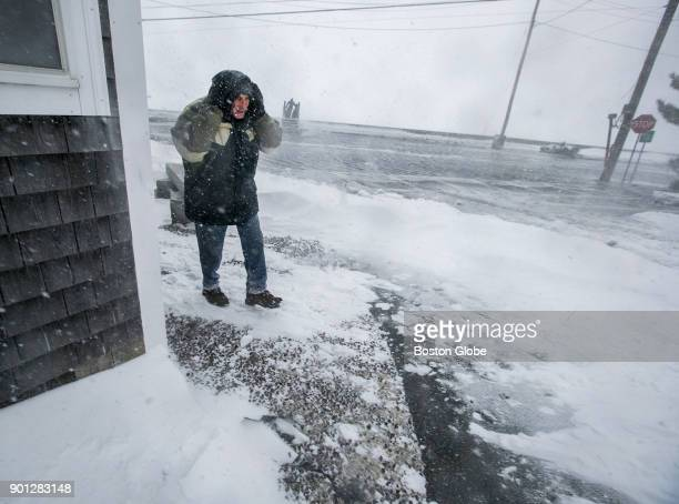A man battles the elements in the Squantum section of Quincy Mass made an island by rushing floodwaters during a storm on Jan 4 2018