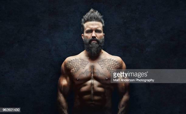 man beard tattoos millennial horz - aggression stock pictures, royalty-free photos & images