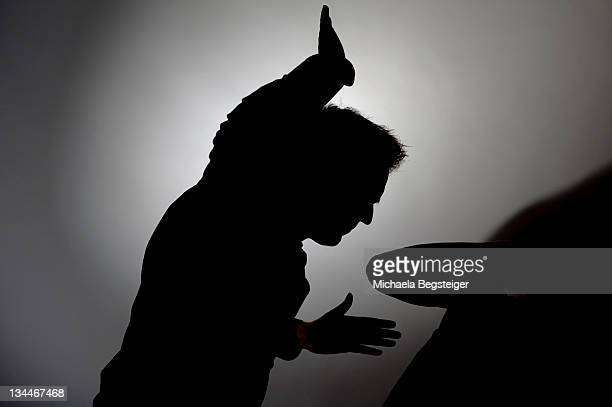 Man beating woman, silhouette
