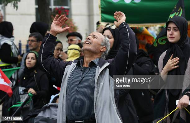 Man becomes emotional and beats his chest as Shiite Muslim mourners take part in a Muharram procession in Toronto Ontario Canada on September 20 2018...