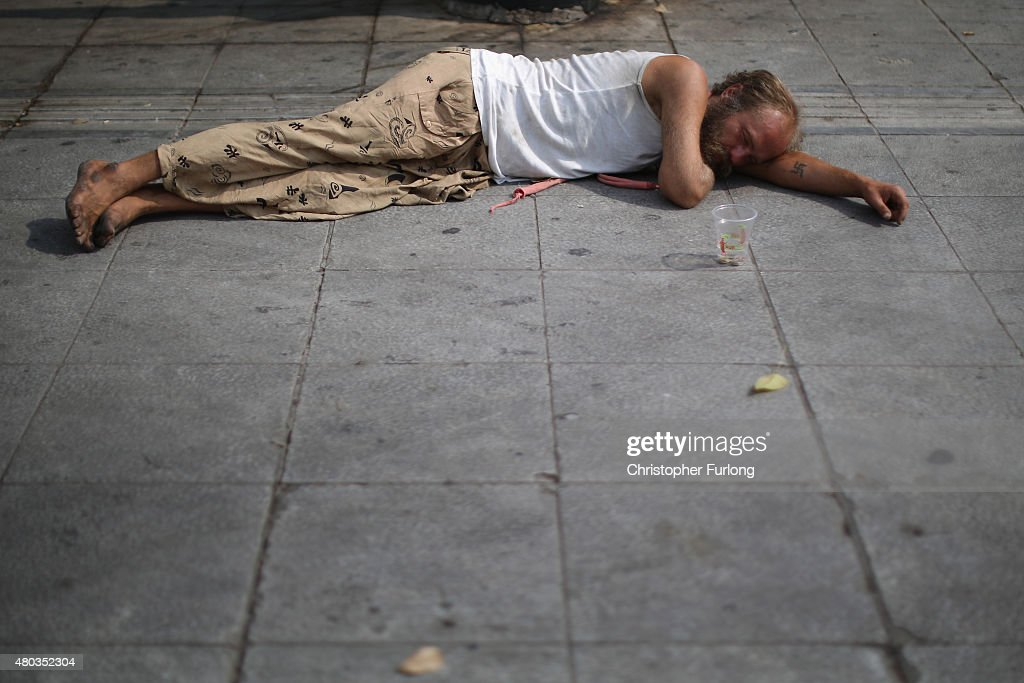 A man begs for coins in Syntagma Square on July 11, 2015 in Athens, Greece. Greek Prime Minister Alexis Tsipras has won the backing of parliament with the new debt proposal which has been given to Greece's creditors - the European Commission, the European Central Bank and the International Monetary Fund. European leaders will meet on Sunday to decide on the country's fate and whether it should stay in the euro.