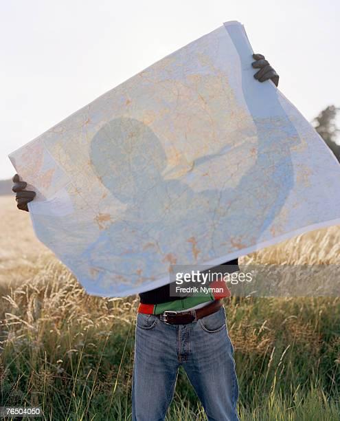 A man behind a map.