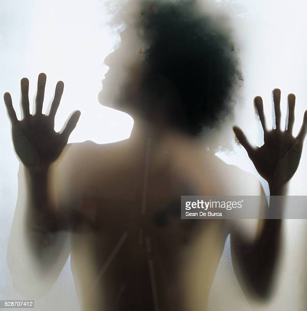 Man Behind Pane of Glass