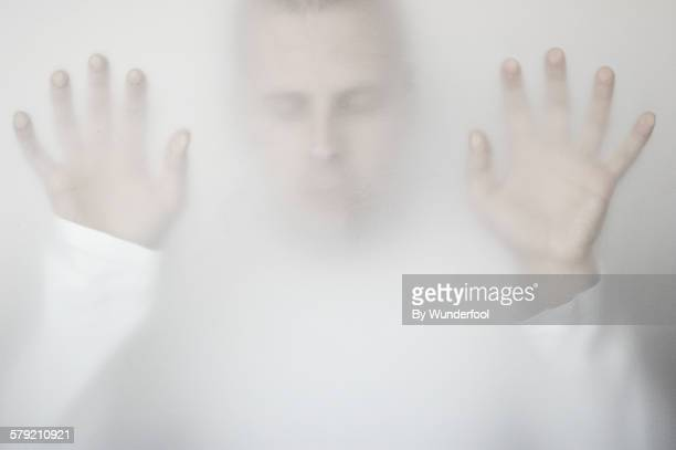 Man behing frosted glass