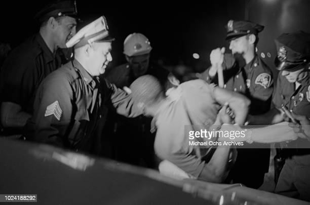 A man being arrested during the 1964 Rochester race riot in Rochester New York State 25th26th July 1964