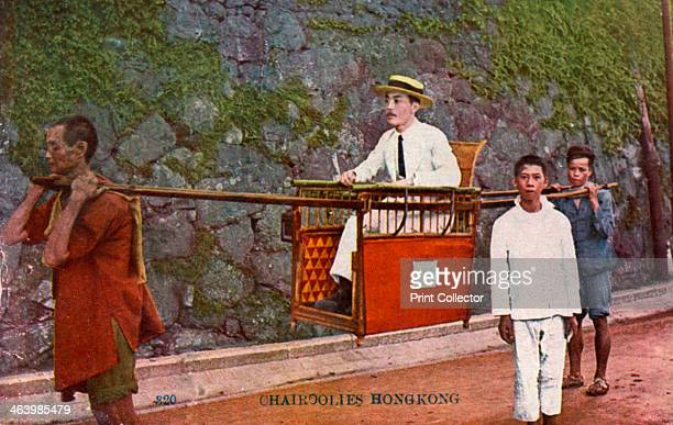 Man being carried on a Sedan chair Hong kong 20th century