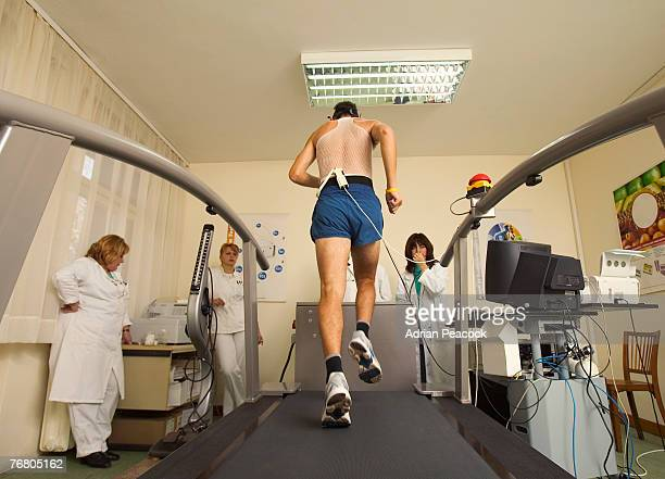 Man being monitored by doctors on a treadmill