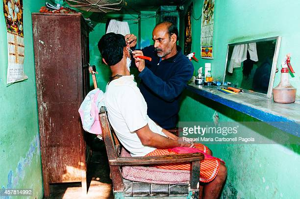 Man being shaved at a barber shop in the old city