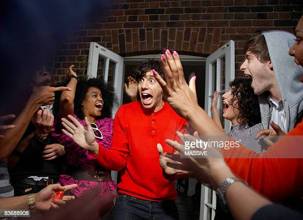 Man being surprised by his friends