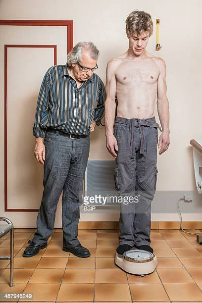 Man being weighed doctor's surgery France