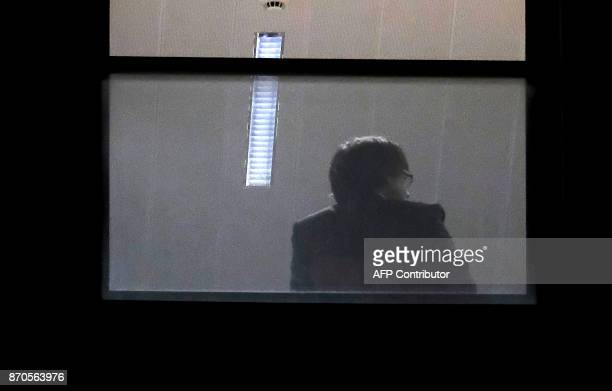 A man believed to be Carles Puigdemont sits inside the public prosecutor's office in Brussels on November 5 2017 Catalonia's sacked separatist leader...