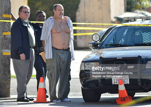 BEACH CALIF USA A man believed to be the suspect in a shooting that killed six people and wounded three others is held by police in an alley near...