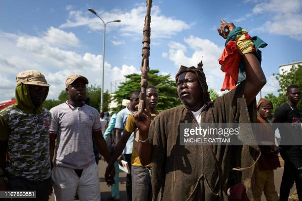 A man belonging to the Dogon ethnic group takes part in a protest in Bamako to claim for security and peace in central Mali on September 13 2019...