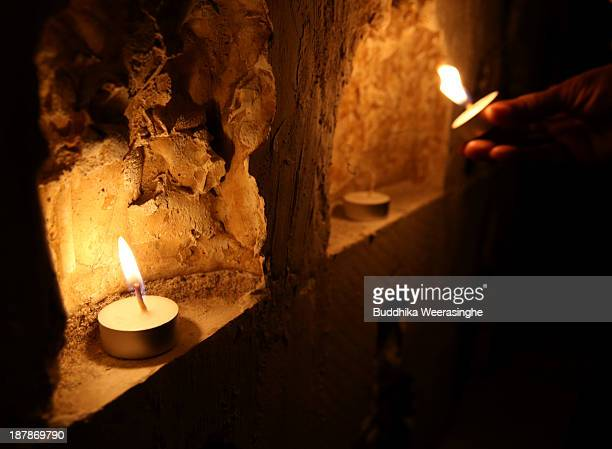 A man belonging to the Sri Lankan minority Tamil ethnic group lights a candle for people killed in the Sri Lankan Civil War between the government...