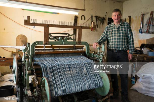 man beside his hattersley loom used for creating tweed cloth - tweed stock pictures, royalty-free photos & images