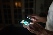 Man betting online at home on his cell phone