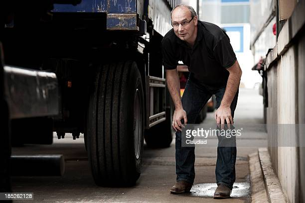 Man between trucks