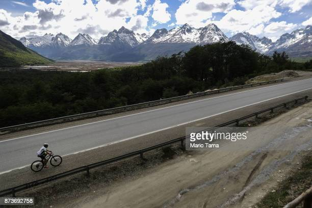 A man bicycles in warm spring temperatures on November 8 2017 in Ushuaia Argentina Ushuaia is situated along the southern edge of Tierra del Fuego in...
