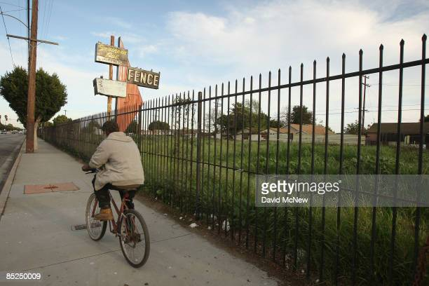 A man bicycles past a lot vacated years ago when a longestablished business failed March 3 2009 in Compton California The city that became known as...
