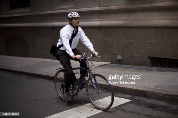 A man bicycles to work near Wall Street and the New York Stock Exchange June 5 2012 in New York City
