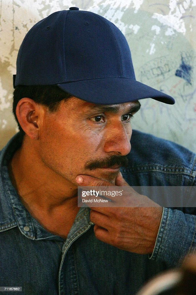 A man bides his time at a 'hospedaje', or guest house, that lodges illegal immigrants on June 5, 2006 in Altar, Mexico, 60 miles south of the border village of Sasabe. More illegal immigrants pass through Altar, where immigrant smuggling is the primary industry, than any other town. Available services include 'coyotes,' or guides, transportation over 60 miles or more of dirt road in vans carrying as many as 25 people, about 150 'hospedajes,' or guest houses, provisions, a free mobile clinic catering mostly to people who were hurt trying to cross the border, and groups who warn immigrants on the dangers of the trek and help those in need. From here, most immigrants are guided through Sasabe, where nightly robberies have become an industry and rape is common, then across the U.S.-Mexico border to walk for about 45 miles through the desert before being picked up by smuggler vehicles. It is during the walk that most of the 473 deaths of 2005 occurred, mostly from exposure to extreme heat and fatigue.