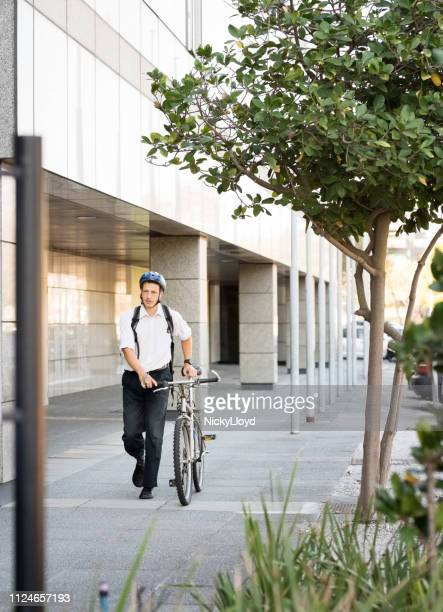 man bike commuting - carbon footprint stock pictures, royalty-free photos & images